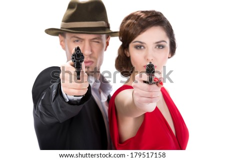 Man gangster and sexy spy woman with guns. Isolated on white background