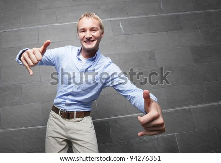 Man gesturing with hands and smiling - stock photo