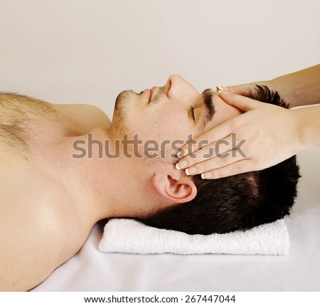 Man getting facial massage - stock photo