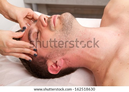 Man getting massage in the beauty center