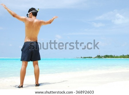 man getting ready to go snorkeling in a tropical island - stock photo