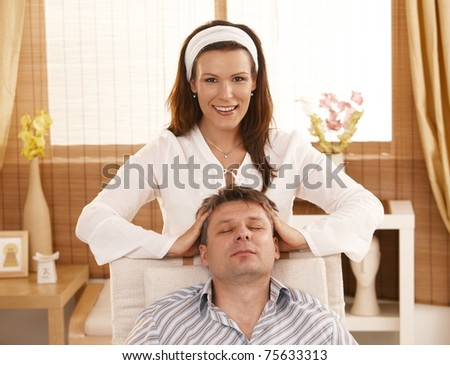 Man getting relaxing head massage in dayspa.? - stock photo