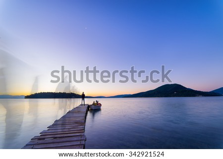 Man ghosty silhouette walking on The pier and beautiful sky - stock photo