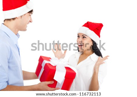 man give present gift box to smile woman, christmas holiday excited happy couple love smiling wear red new year hat cap, isolated over white background