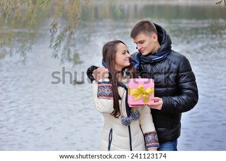 man gives a woman a gift. - stock photo