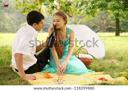 Man gives his wife to smell wine - stock photo