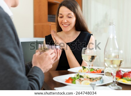 man gives jewelry girlfriend during dinner - stock photo