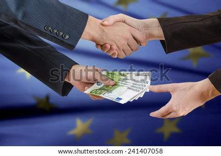 man gives the woman the money as a bribe - stock photo