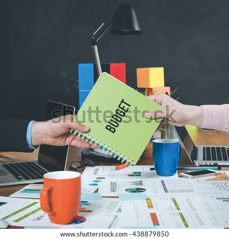 Man giving book which written Budget - stock photo