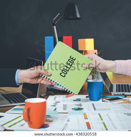 Man giving book which written College - stock photo