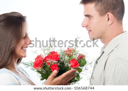 Man giving bouquet of flowers to his girlfriend isolated on white. - stock photo