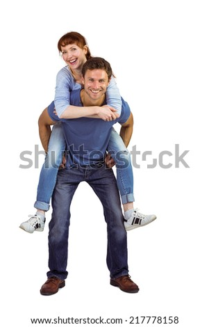 Man giving girl a piggy back on white background
