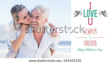 Man giving his smiling wife a piggy back at the beach against i love you message - stock photo