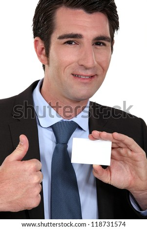 Man giving ok gesture whilst holding business card - stock photo