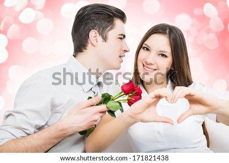 Man giving red rose to a woman, she make hearth by hands.White background  - stock photo