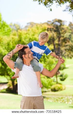 Man giving son a piggyback - stock photo