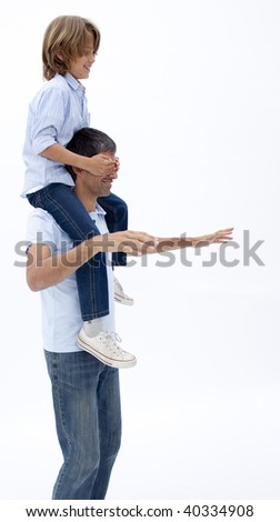 Man giving son piggy back ride with eyes closed against white background