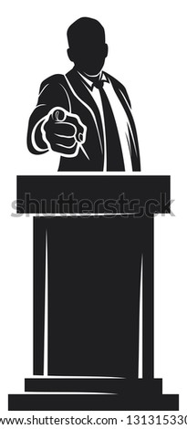 man giving speech (orator speaking at a podium, man speaking at a conference, man giving speech with tribune, politician speaker, politician pointing to the viewer, hand pointing , finger pointing) - stock photo