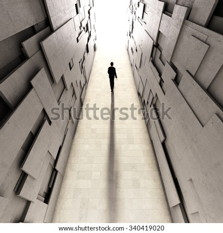 Man goes to bright light through long concrete tunnel - stock photo