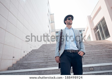 Man going down the stairs, view from below - stock photo