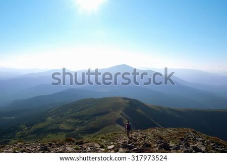 Man going down through a trail, beautiful landscape - stock photo