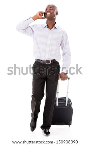 Man going on a business trip and talking on the phone - isolated over white  - stock photo