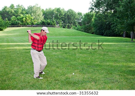 Man golfing on a summer day. - stock photo