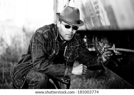 man grabbing hold of a train - stock photo