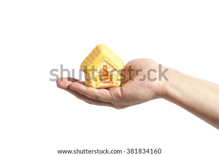 Man hand and toy house isolated on white; real estate presentation - stock photo