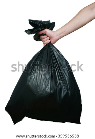 Man hand carry garbage in plastic bag for eliminate isolated on the white background. - stock photo