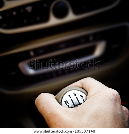 Man hand changing the speed. - stock photo