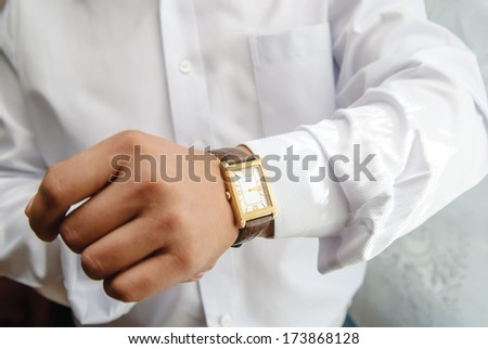 man, hand,clock - stock photo