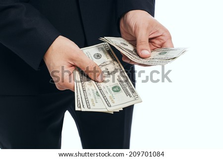 Man hand counting dollar banknotes, isolated on a white background