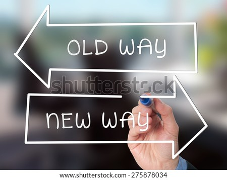 Man Hand drawing Old Way or New Way concept with marker on visual screen. Stock Image - stock photo