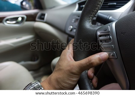 man hand drive the car.