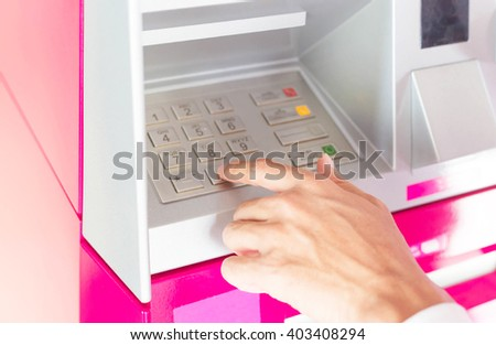 Man hand enter number on atm machine to withdraw money - stock photo
