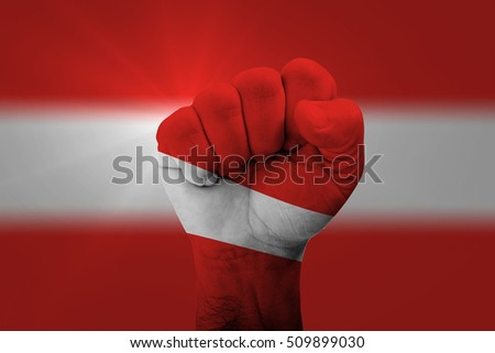 Man hand fist of AUSTRIA flag painted