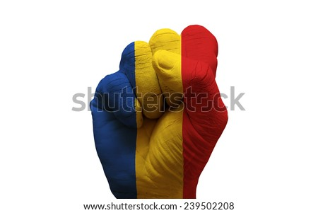 man hand fist painted country flag of romania - stock photo