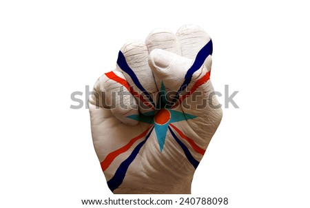 man hand fist painted flag of assyrian people - stock photo