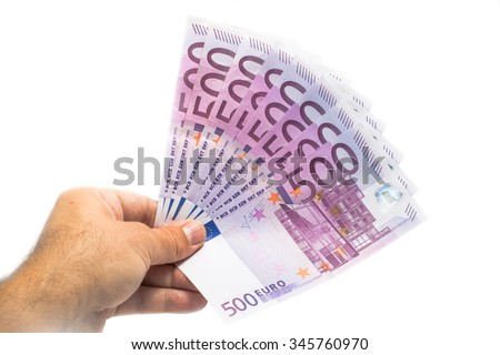 man hand giving 500 euro banknotes isolated on white - stock photo