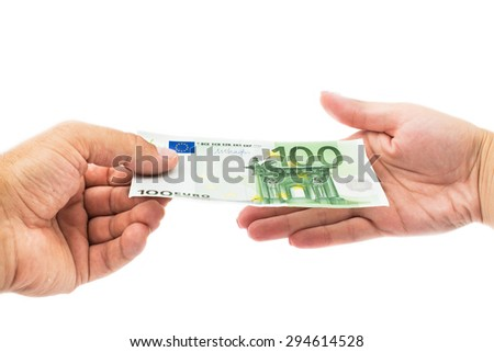 man hand giving 100 euro to woman hand - stock photo
