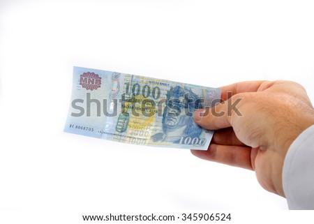 man hand giving 1000 forint banknote isolated isolated on white