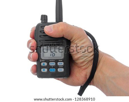 Man hand grasping marine radio. Channel 16 is active - stock photo