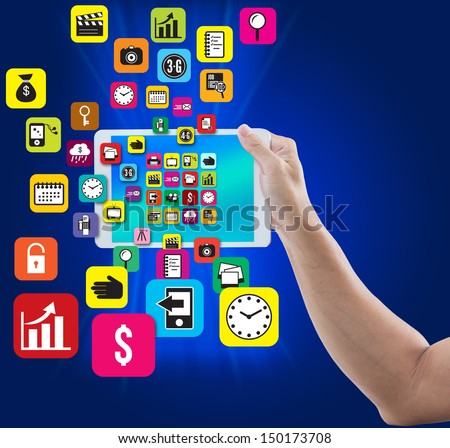 Man hand hold digital tablet with colorful application and social media icon on blue background - stock photo