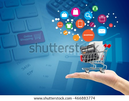 Man hand hold market cart sign shopping online concept keyboard shopping online background