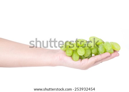 Man hand holding a bunch of green grapes, Isolated on white background. - stock photo