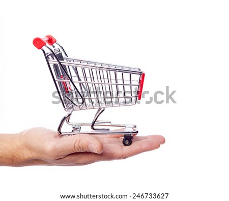 Man hand holding a shopping cart, isolated over white background