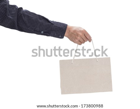 Man hand holding brown paper bag isolated on white background with clipping path - stock photo