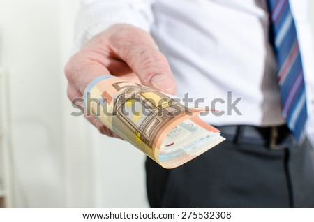 Man hand holding different euro notes