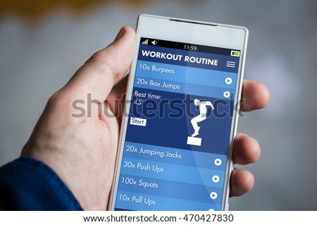 man hand holding fitness app smartphone. All screen graphics are made up.